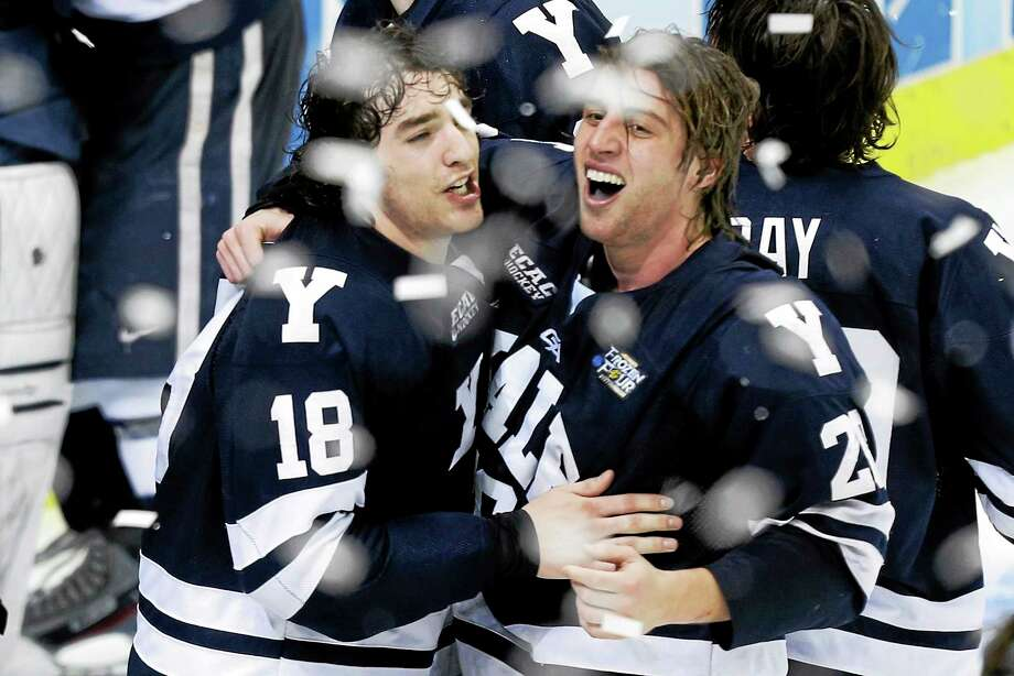 Jesse Root, right, who helped Yale win a national title in 2013, has signed a one-year, two-way contract with the Dallas Stars organization. Photo: The Associated Press File Photo   / AP