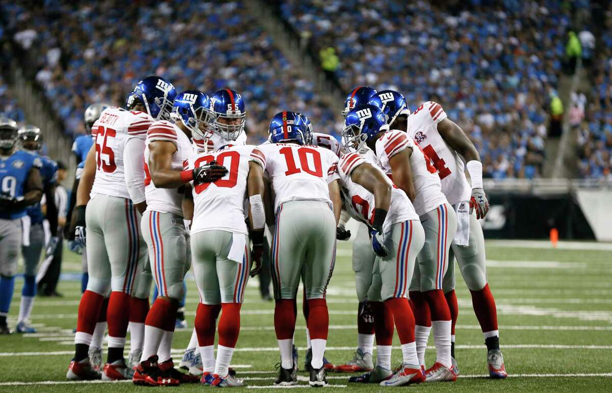 New York Giants quarterback Eli Manning (10) huddles the offense against the Detroit Lions during a Sept. 8 game in Detroit.