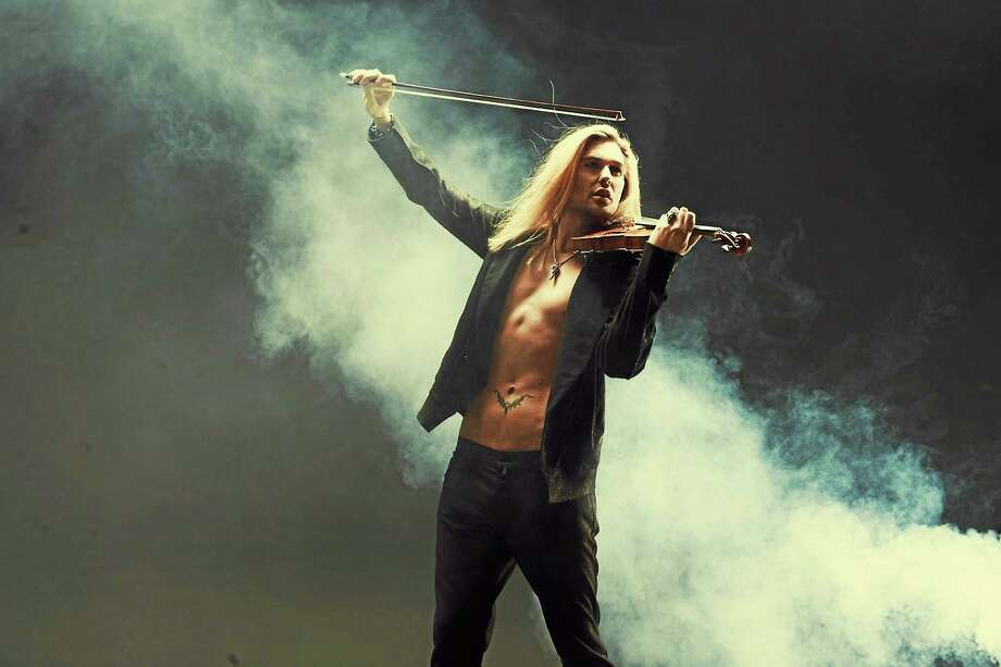 """contributed  Rocking violinist David Garrett, who's touring behind his latest album """"Music,"""" attracts a diverse audience in age and musical taste. Photo: Journal Register Co."""