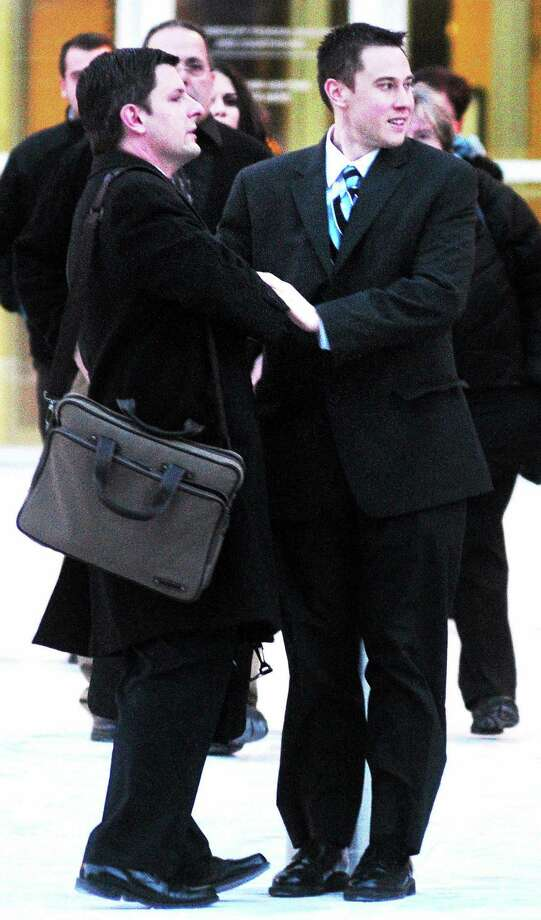 Former East Haven police Officer Dennis Spaulding, right, leaves federal court in Hartford Thursday after being sentenced to 5 years in prison. Photo: Arnold Gold — New Haven Register