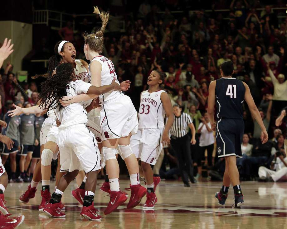 Stanford players celebrate after their 88-86 overtime win over UConn on Monday. Photo: Marcio Jose Sanchez — The Associated Press    / AP