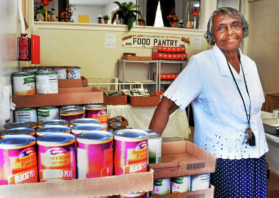 Paster Bernice in the food pantry attached to the Glorified Deliverence Church in New Haven 6/28. Photo: Melanie Stengel — New Haven Register