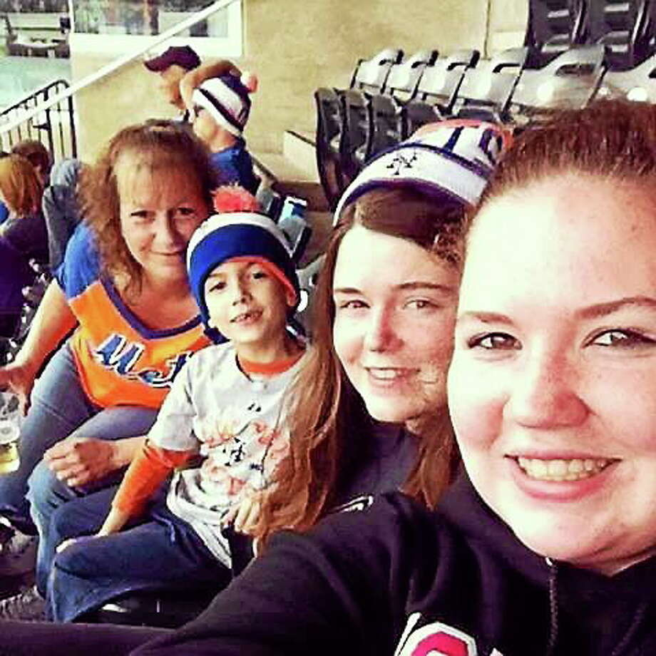 Pictured from left, Oxford resident Heather Bruno, with her children,Tony Bruno, 8, Lauren Barry, 18, and Jessica Barry, 20. / Contributed photo Photo: Journal Register Co.