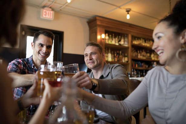Millennials drinking beer in a bar