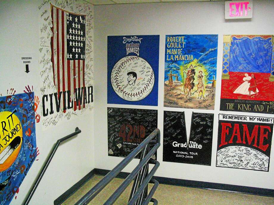 """The """"graffiti"""" posters of shows on the walls leading to the dressing rooms. Photo: Shubert Theatre Photo"""