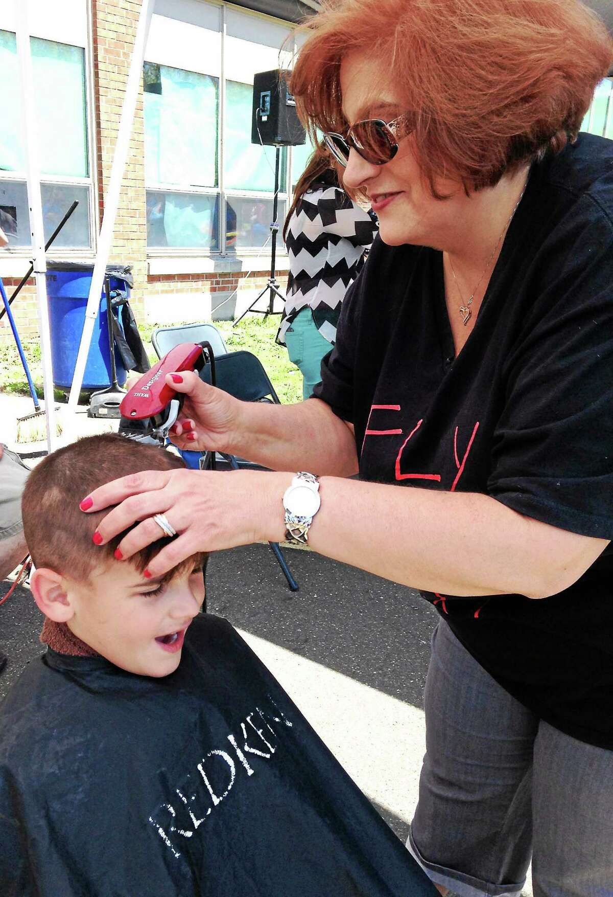 Gavin Fanelli, a student at Seth G. Haley Elementary School, gets his head shaved during the first Westie Day of Hope event at West Haven High School Sunday.