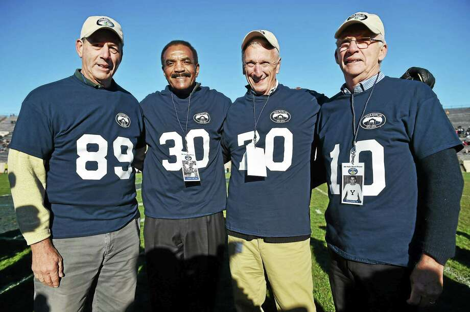 From left, tight end Bruce Weinstein, running back Calvin Hill, offensive tackle Kyle Gee and quarterback Brian Dowling were among 67 former Yale football players honored at halftime of the Bulldogs' 44-30 win over Princeton on Saturday as part of the Yale Bowl's centennial celebration. Photo: Catherine Avalone — Register   / New Haven RegisterThe Middletown Press