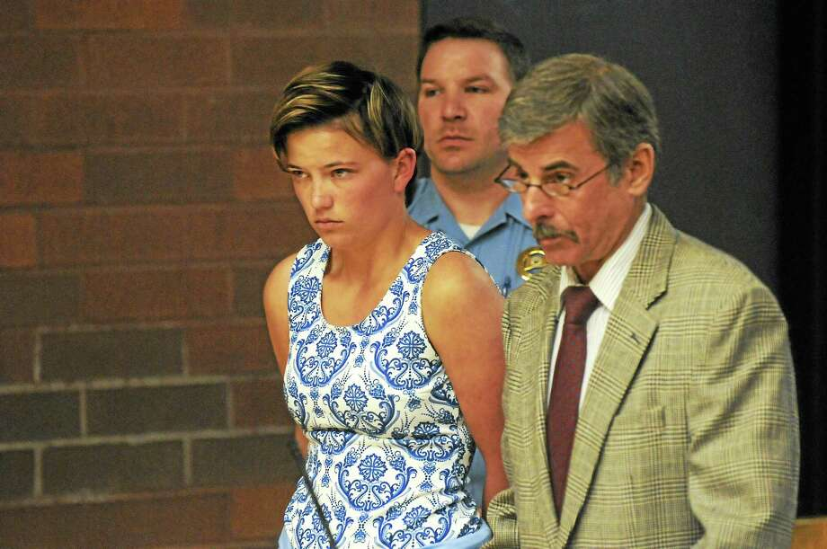 Danielle Shea, 22, charged with first-degree threatening in connection with bomb threats made to Quinnipiac University, and  her attorney Mark Buebendorf in court Monday. Photo: Patrick Raycraft — Hartford Courant   / 20100519\B583743015Z.1