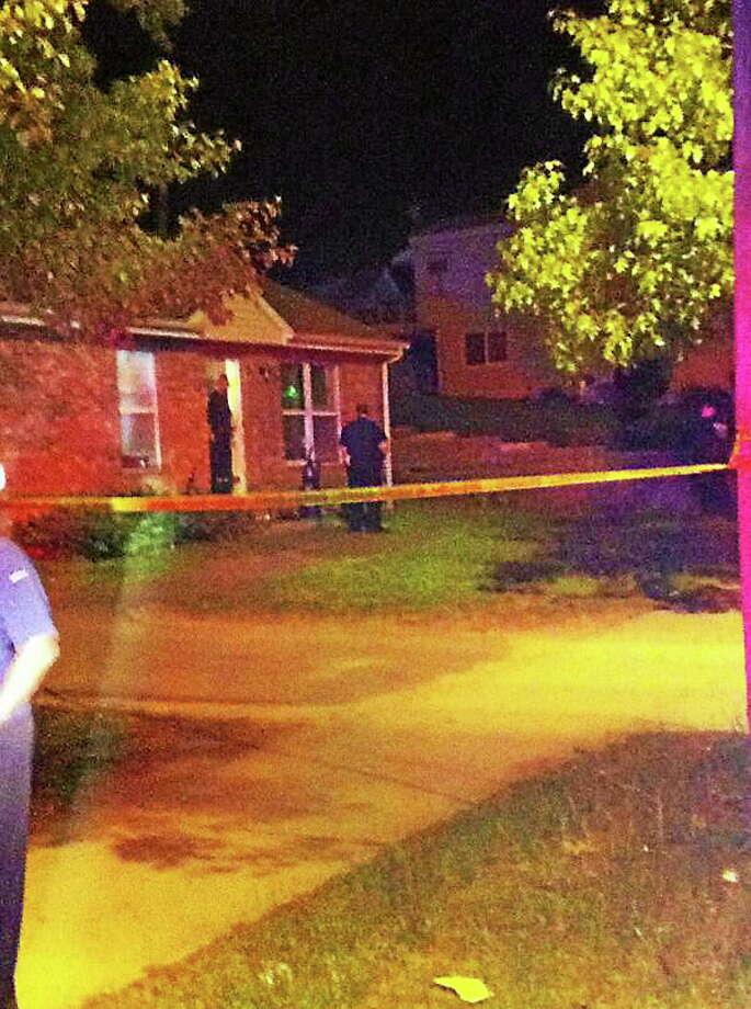 Police investigate a triple shooting Monday night near Quinnipiac Avenue. Photo: Keldy Ortiz/New Haven Register