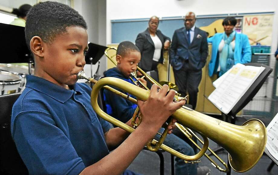 Amani Richards, 12 plays the trumpet and Xavier Jenkins, 10, on the trombone at band class at the after school program at the Lincoln-Bassett School in the Newhallville area of New Haven Monday afternoon, November 10, 2014. In the background, Principal Janet Brown-Clayton, Connecticut Center for Arts and Technology (ConnCAT) CEO Erik Clemons and ConnCat Director of Programs, Genevieve Walker. Photo: (Catherine Avalone — New Haven Register)    / New Haven RegisterThe Middletown Press