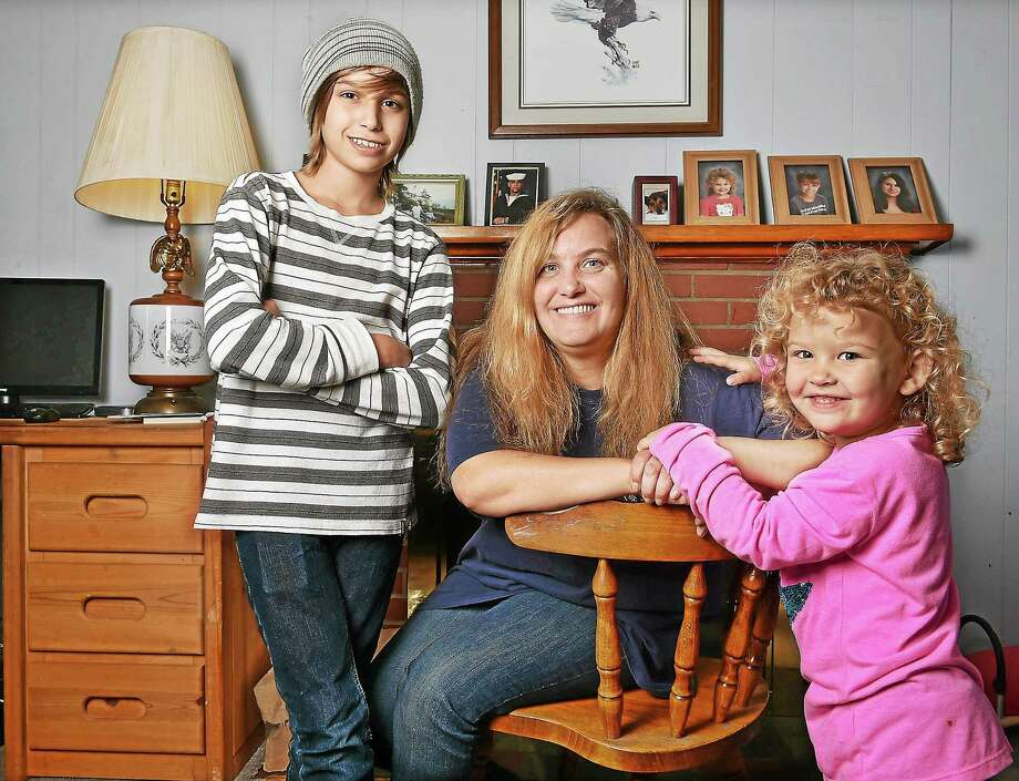 Trish Kallman and her two younger children, Jesse, 13 and three-year-old Julie in their Milford home. Kallman and her husband Bill also have a 15-year-old daughter, Jennifer and are struggling to make ends meet. Photo: (Catherine Avalone — New Haven Register)    / New Haven RegisterThe Middletown Press