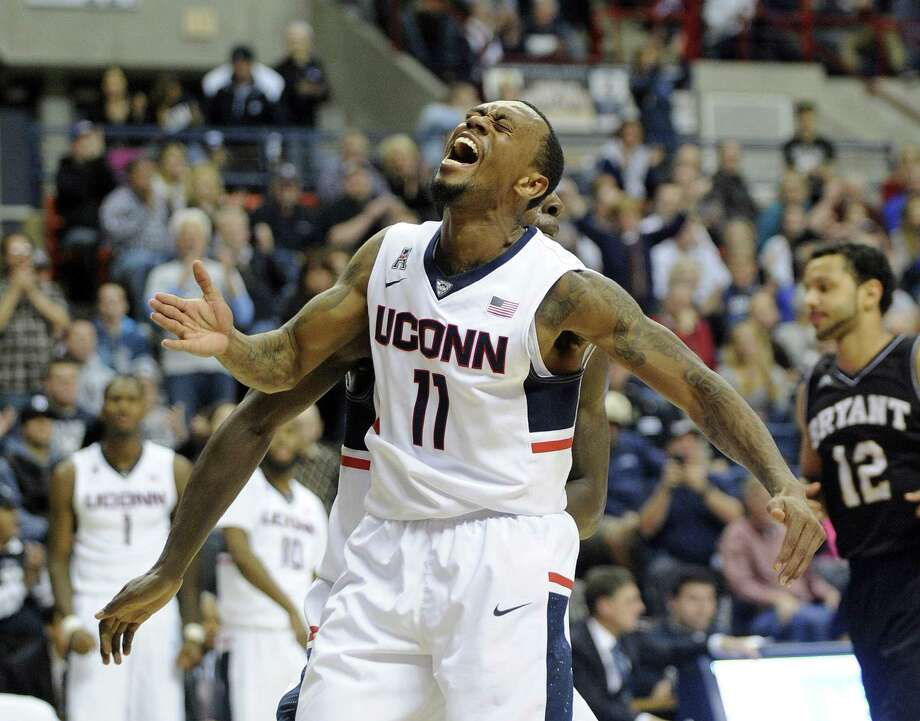UConn's Ryan Boatright celebrates during the second half of the 17th-ranked Huskies' 66-53 win over Bryant on Friday night at Gampel Pavilion in Storrs. Photo: Fred Beckham — The Associated Press   / FR153656 AP