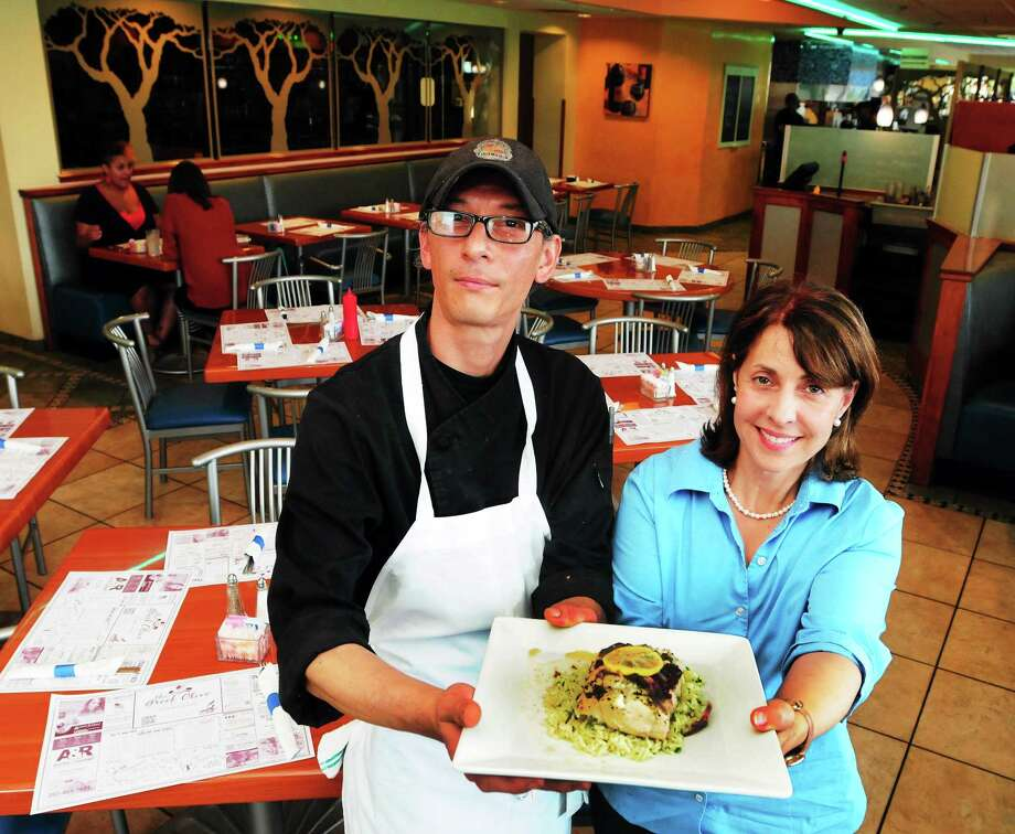 Chef Kam Tom and Greek Olive co-owner Anna Antonakis were happy to share the recipe for the New Haven restaurant's Cod Fish Papillote. Photo: Peter Hvizdak — Register   / ©Peter Hvizdak /  New Haven Register