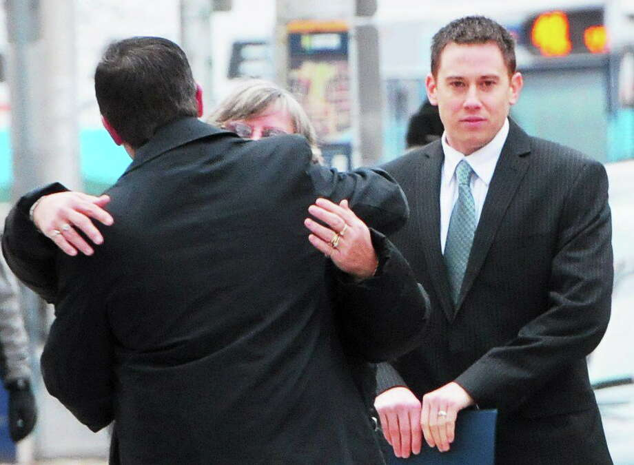 Former East Haven police Officer Dennis Spaulding, right, arrives at U.S. District Court in Hartford Tuesday morning. His sentencing was delayed until Thursday due to the snowstorm, but fellow former Officer David Cari was sentenced to 30 months in prison. Photo: Peter Hvizdak — New Haven Register       / ©Peter Hvizdak /  New Haven Register