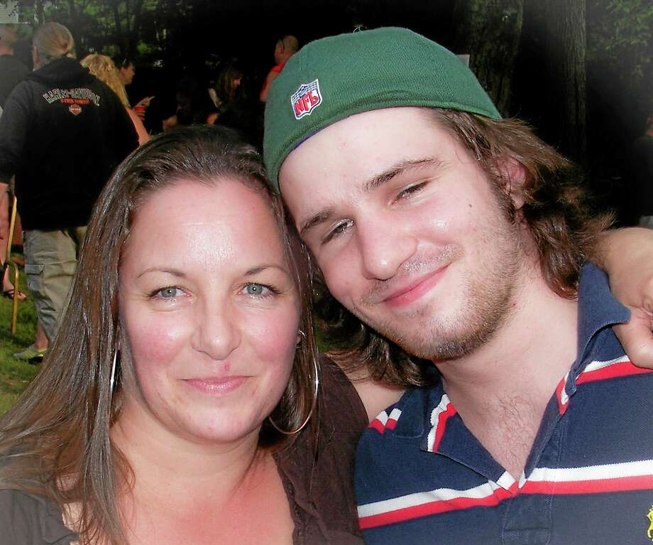 "This 2012 photo provided by Sandy Bannon shows Margaret Rohner, left, with her son, Robert O. ""Bobby"" Rankin. The day after Christmas 2013, Rohner, 45, was attacked with a fireplace poker, her eviscerated body left in the living room of her Deep River home. Rankin, 23, was charged with murder. (AP Photo/Sandy Bannon) Photo: AP / Sandy Bannon"
