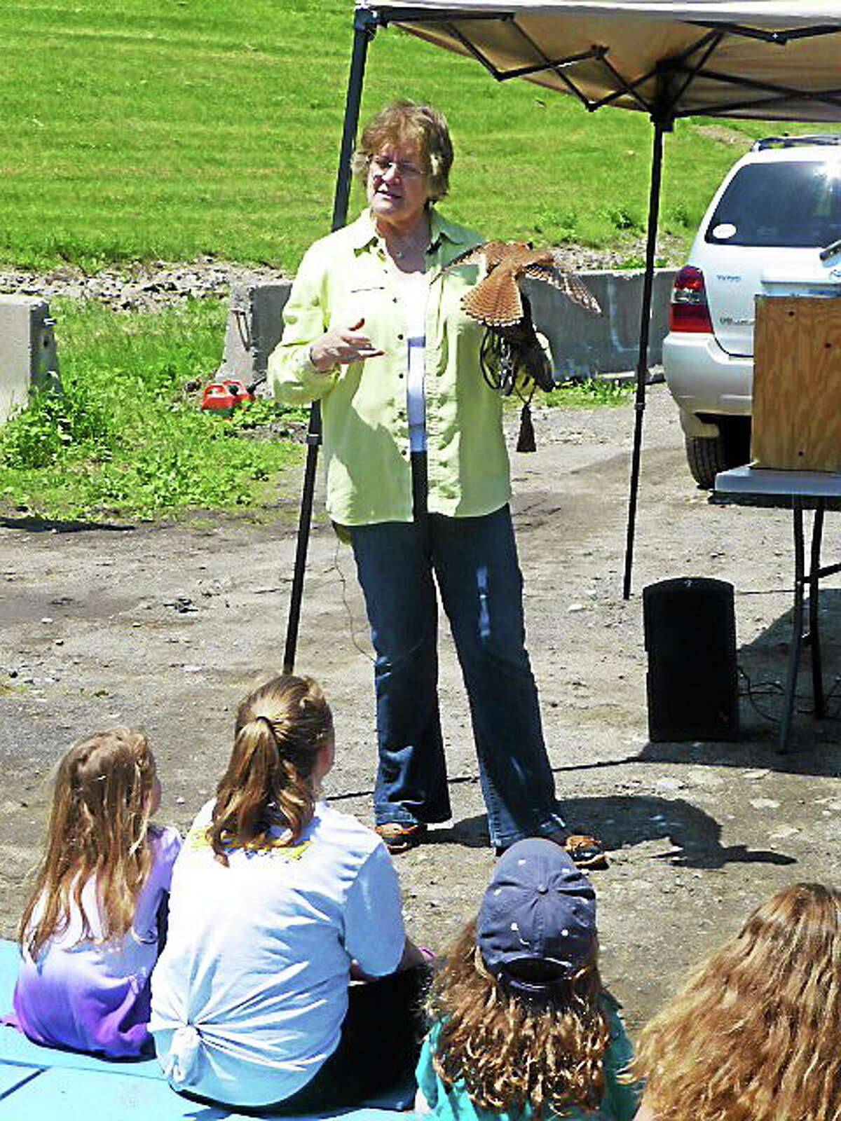 Grace Krick from A Place Called Hope, a rehabilitation center for birds of prey in Killingworth, introduces an American Kestrel to the audience Saturday at Ecofest in Derby. Patricia Villers/Register