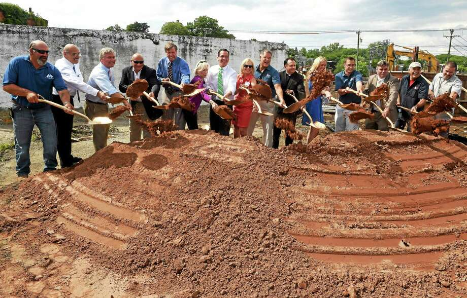 Stony Creek Brewery founders Peggy and Ed Crowley Sr., eight and ninth from left, along with brewery employees, construction representatives, politicians, dignitaries and friends take part in a ground-breaking ceremony Thursday at the future site of the Stony Creek Brewery at 5 Indian Neck Ave. in Branford. Photo: Peter Hvizdak — New Haven Register    / ©Peter Hvizdak /  New Haven Register