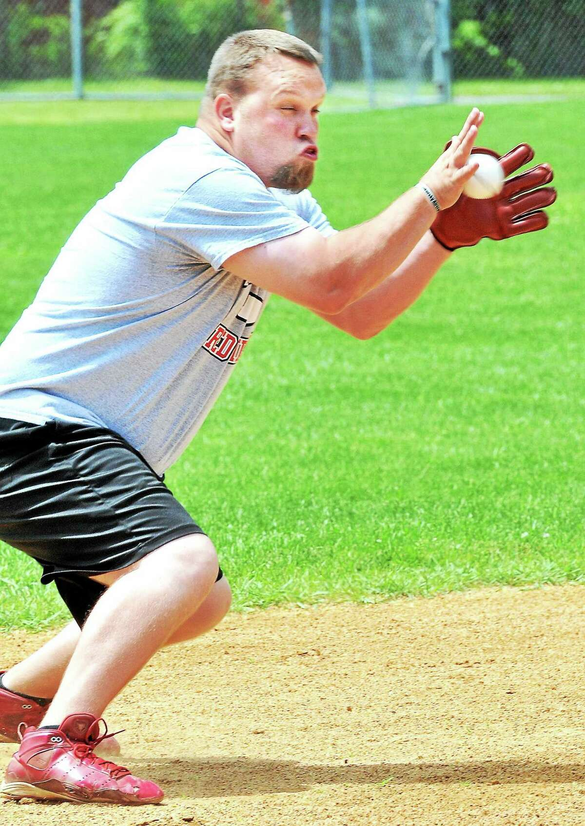 George French of Derby fields a grounder during practice using a 19th century replica baseball glove at Nolan Field in Ansonia on 6/20/2014.