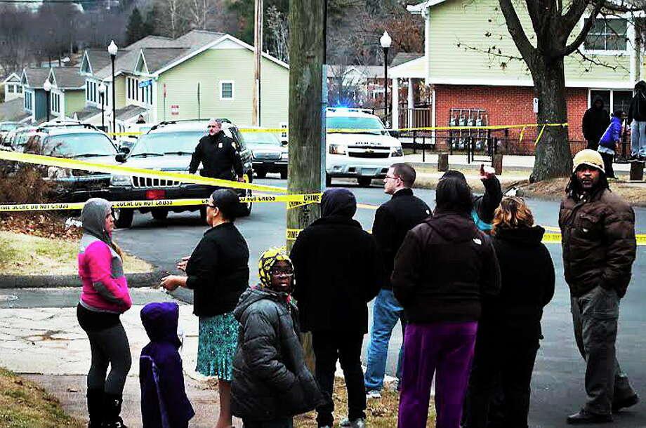 People gather near Eastern Street shooting scene. Photo: Melanie Stengel—New Haven Register