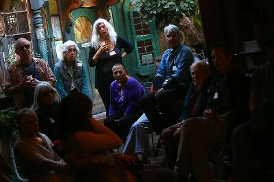 Christine Damen, center, co-hosts a Death Cafe event at 7 Squid Row in on Sunday, Nov. 10, 2013 in Santa Cruz, Calif. More than 20 participants took part in a conversation about death and grief at the event. Photo: ARIC CRABB / BAY AREA NEWS GROUP