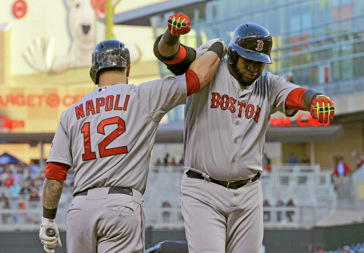 The Red Sox's David Ortiz, right, celebrates with Mike Napoli (12) after hitting a solo home run off Minnesota Twins starting pitcher Kevin Correia during the third inning Wednesday.