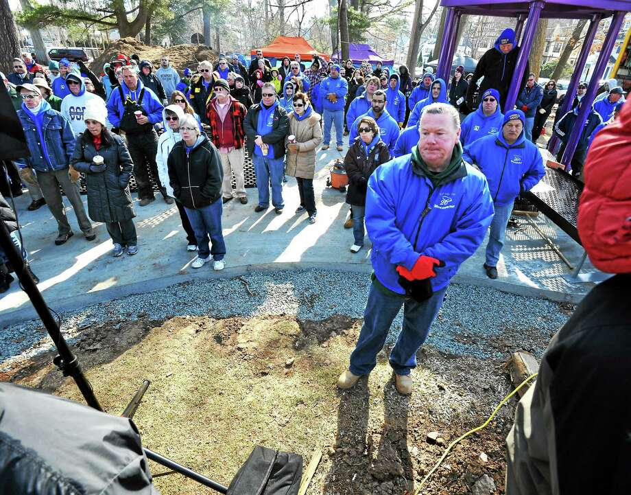 Where Angels Play Foundation founder William Lavin, right, pauses in memory of  Ana Marquez-Greene who died in the Sandy Hook shootings. A playground building project got underway Sunday at Elizabeth Park, Hartford, in memory of Ana. Photo: (Mara Lavitt - New Haven Register)    / Mara Lavitt