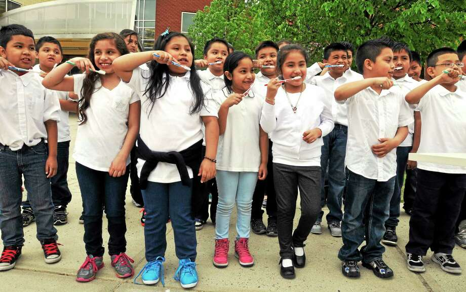 The Fair Haven Community Health Center celebrated its new Mobile Dental Clinic at an event at the John S. Martinez School. Martinez students sang a song about brushing their teeth. Photo: Mara Lavitt — New Haven Register      / Mara Lavitt