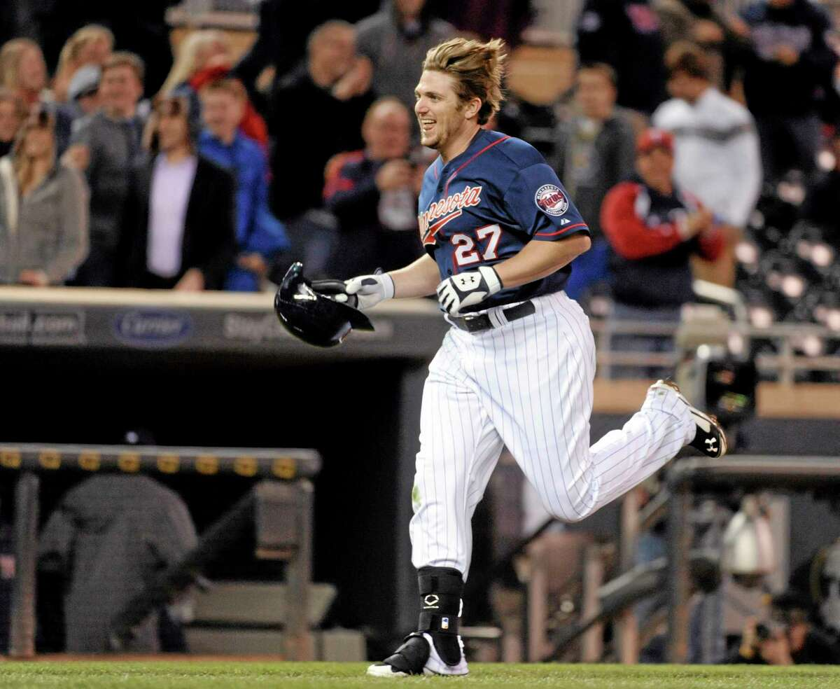 The Twins' Chris Parmelee nears home plate after hitting a game-winning two-run home run off Boston Red Sox pitcher Andrew Miller during the ninth inning.