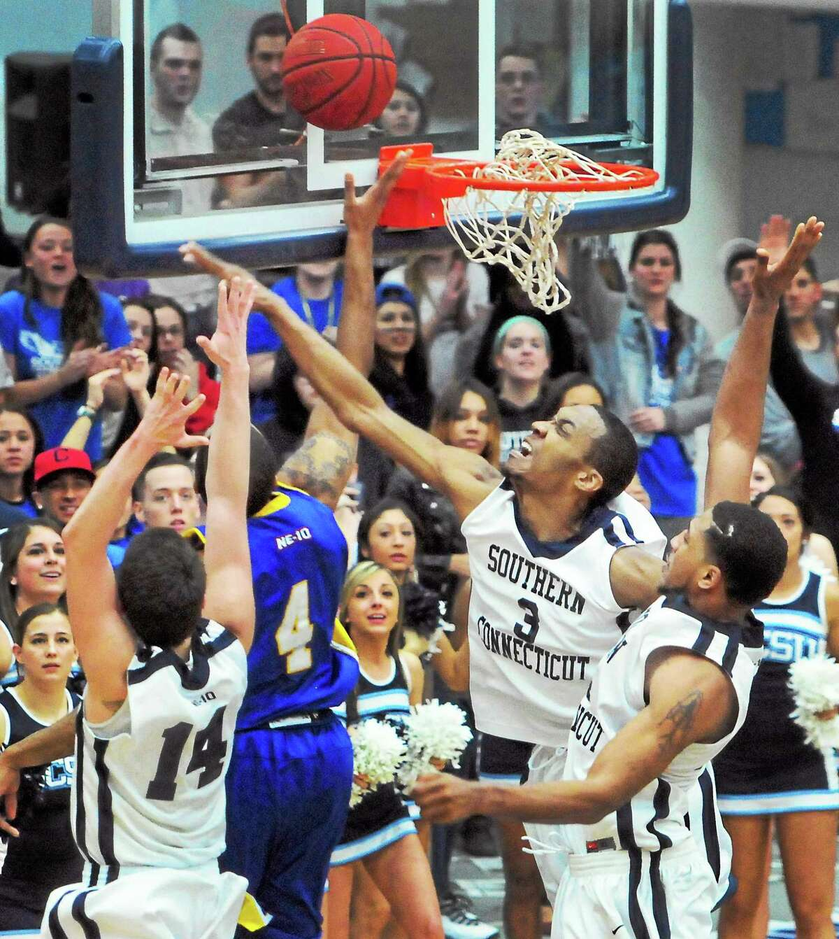 Jeffery Adkins (4) and second-seeded New Haven will take on No. 7 Bloomfield on Saturday afternoon at Moore Field House in New Haven in the first round of the NCAA Division II tournament.