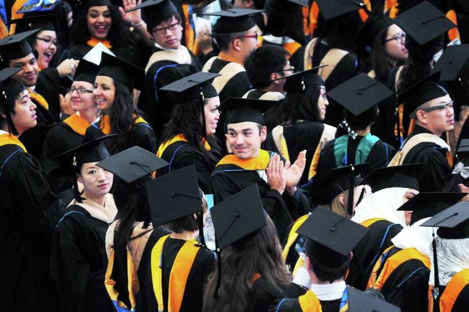 University of New Haven graduates applaud their parents and faculty during commencement ceremonies at the David A. Beckerman Recreation Center in West Haven Saturday. See a photo slideshow at nhregister.com. Photo: Arnold Gold — New Haven Register