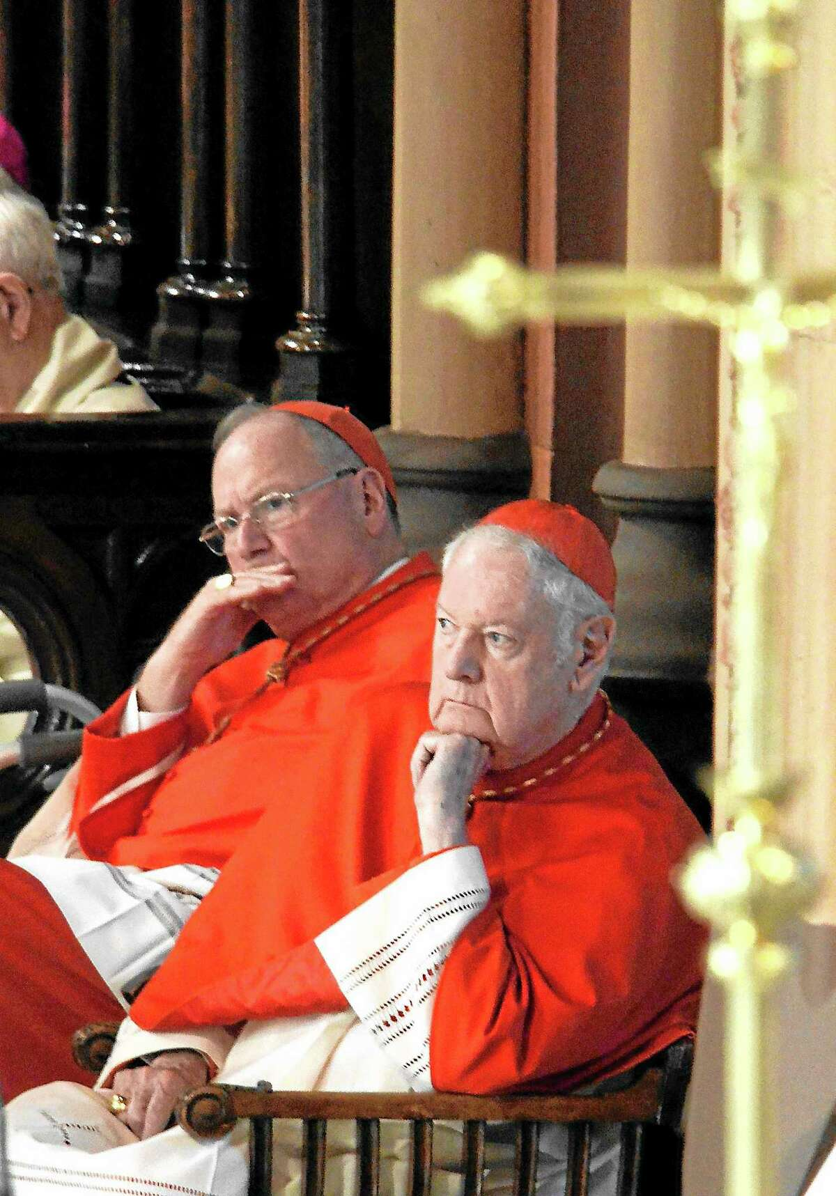 Cardinal Timothy Dolan and retired Cardinal Edward Egan listen to Hubbard in Albany on Sunday, Oct. 20, 2013 .