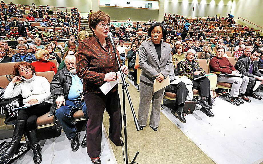 (Mara Lavitt — New Haven Register)   A public information meeting about tree trimming was held March 6 by the CT Public Utilities Regulatory Authority (PURA) at the Hamden Middle School. Residents and elected officials from greater New Haven attended. New Haven's Tree Warden and Deputy Director of Parks and Squares, Christy Hass, left, and New Haven Mayor Toni Harp spoke first. mlavitt@newhavenregister.com Photo: Journal Register Co. / Mara Lavitt