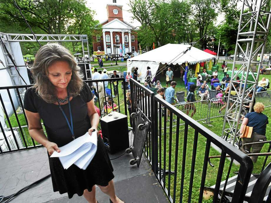 Mara Lavitt - New Haven Register   International Festival of Arts & Ideas Artistic Director Mary Lou Aleskie goes over last-minute details before La Santa Cecilia performed the closing concert on the New Haven Green on June 28. Photo: Journal Register Co. / Mara Lavitt