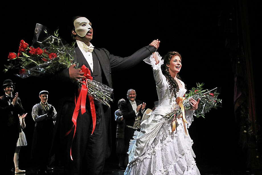 In this May 12, 2014 photo, Norm Lewis, left, and Sierra Boggess acknowledge applause on the pair's opening night with the Broadway production of The Phantom of the Opera at The Majestic Theatre in New York. Lewis is the first African-American actor to take on the title role. Photo: AP Photo/The Publicity Office, Bruce Glikas   / The Publicity Office