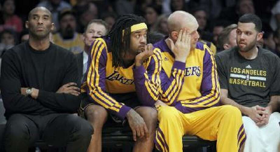 Kobe Bryant watches from the bench of a 94-79 loss to the Milwaukee Bucks.