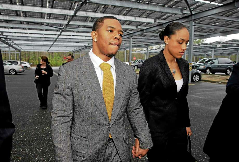 Baltimore Ravens football player and former Rutgers University standout, Ray Rice holds hands with his wife Janay Palmer as they arrive at Atlantic County Criminal Courthouse in Mays Landing, N.J., Thursday, May 1, 2014. After Rice and Janay Palmer got into a physical altercation on Feb. 15 at an Atlantic City casino, both were charged with simple assault-domestic violence. (AP Photo/Mel Evans) Photo: AP / AP