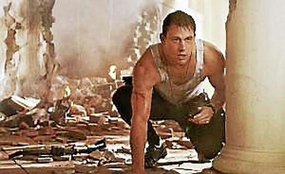 """This film publicity image shows Channing Tatum in a scene from """"White House Down."""" Photo: (Sony Columbia Pictures, Via The Associated Press)"""