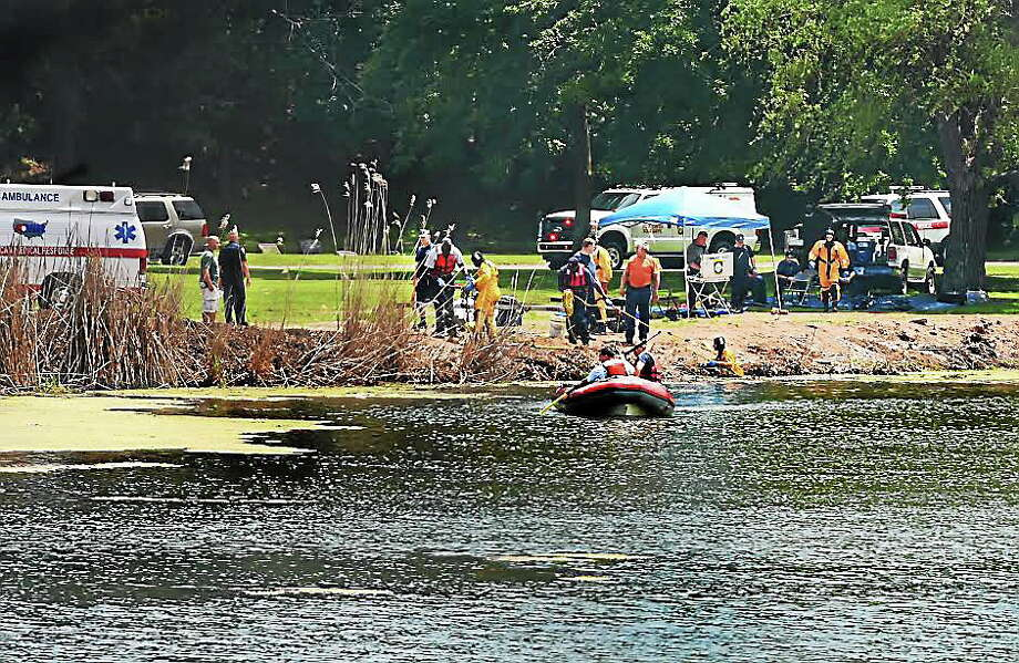 Emergency responders search the pond at Evergreen Cemetery in New Haven July 12. Photo: Melanie Stengel — New Haven Register