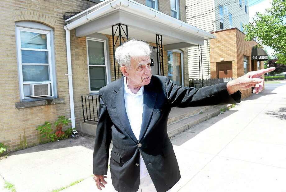 Former Hamden Mayor John Carusone talks about the tornado that hit Hamden on July 10, 1989, during a tour of the formerly devastated section of Dixwell Avenue on July 11, 2014. Photo: (Arnold Gold — New Haven Register)