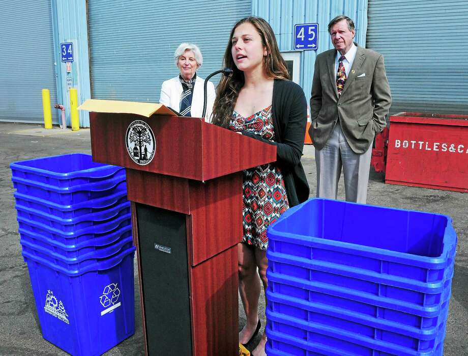 State Rep. Pat Widlitz, left, and state Sen. Ed Meyer, right, listen to Branford High School student Etta Hanlon speak about her holiday recycling program. Photo: Arnold Gold — New Haven Register