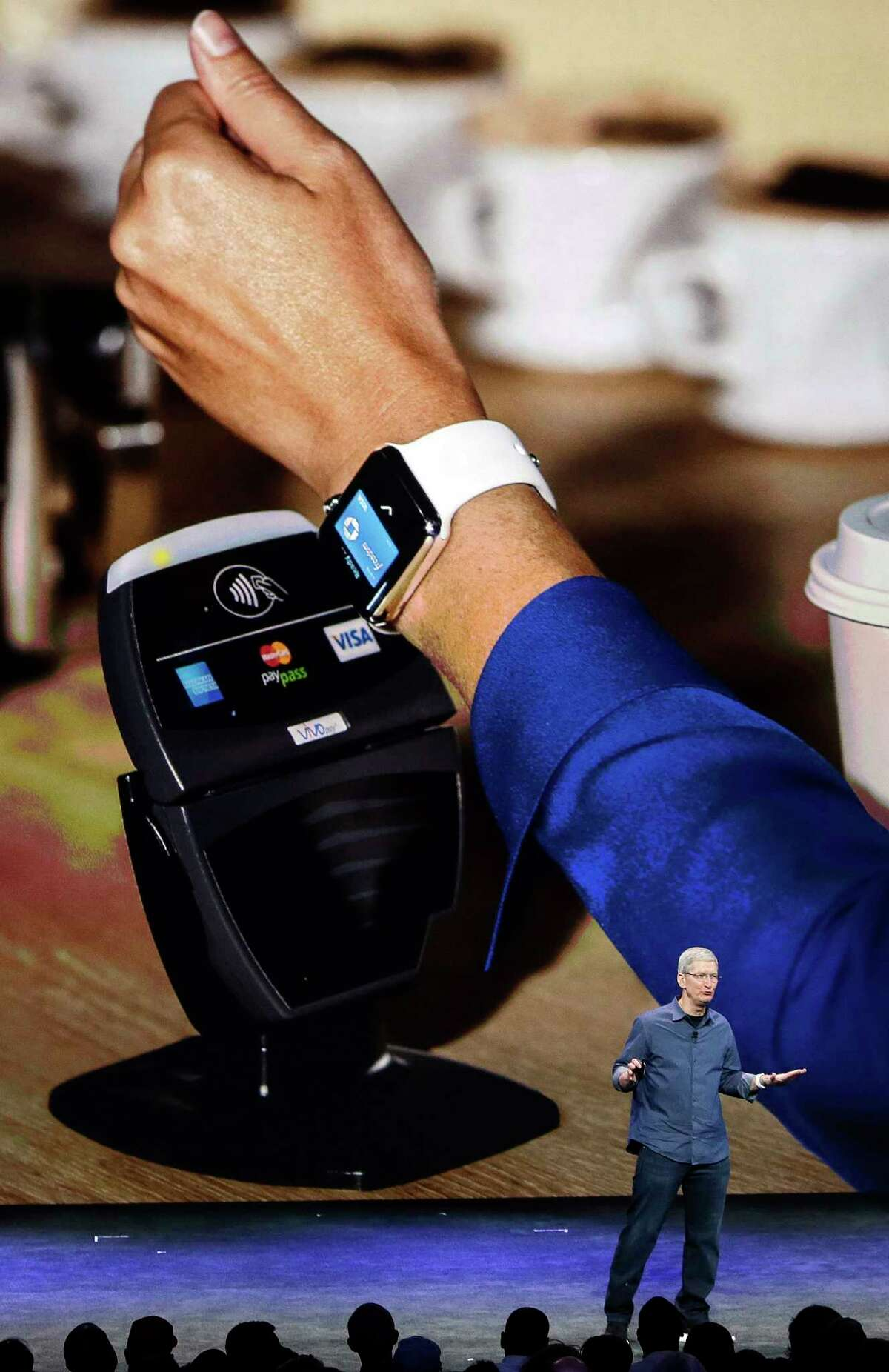 Apple CEO Tim Cook explains how the Apple Watch works in conjunction with Apple Pay during an announcements of new products on Tuesday, Sept. 9, 2014, in Cupertino, Calif.
