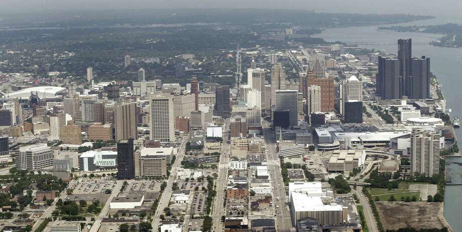 FILE - This July 17, 2013 aerial photo shows the city of Detroit. On Friday, Nov. 7, 2014, federal bankruptcy judge Steven Rhodes is expected to decide whether Detroit's plan to exit bankruptcy is fair and feasible. (AP Photo/Paul Sancya, File) Photo: AP / AP