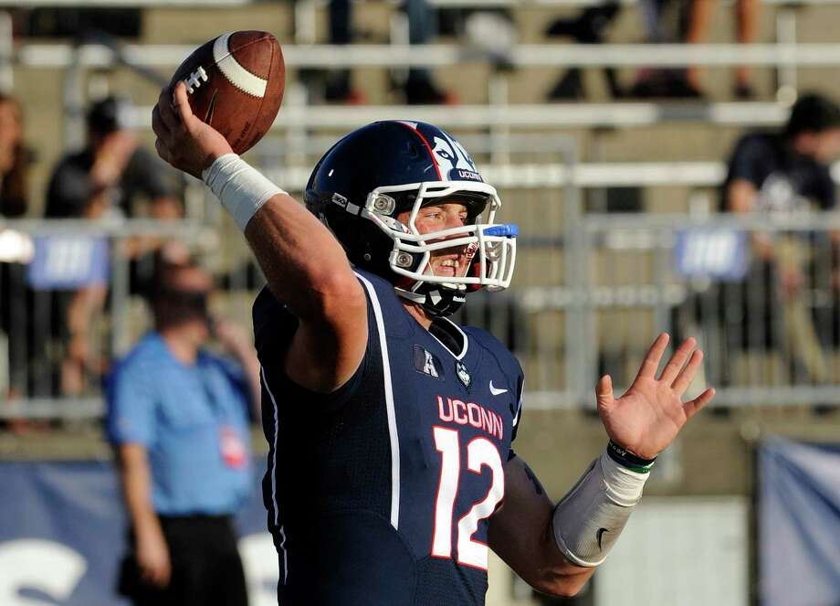 UConn quarterback Casey Cochran warms up before a game against BYU last month. Photo: Fred Beckham — The Associated Press   / FR153656 AP
