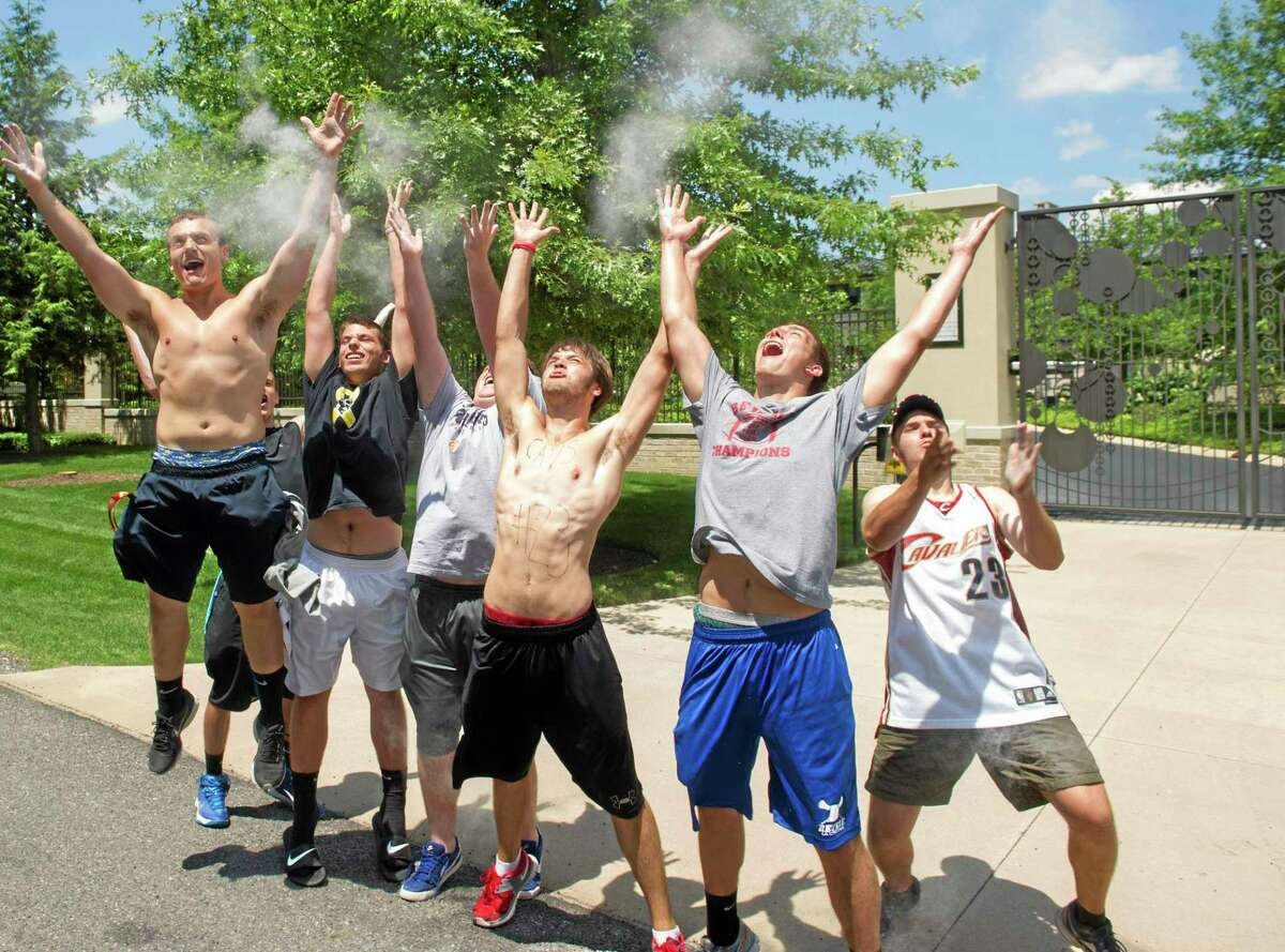 Cleveland Cavaliers fans celebrate in front of the house of LeBron James in Bath, Ohio, after learning of James' decision to sign as a free agent with the Cavs on Friday.