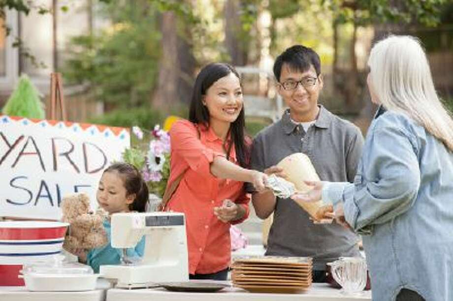 A yard sale is the more traditional and oldest form of clearing out home and garage. Photo: Getty Images/Vetta / Vetta