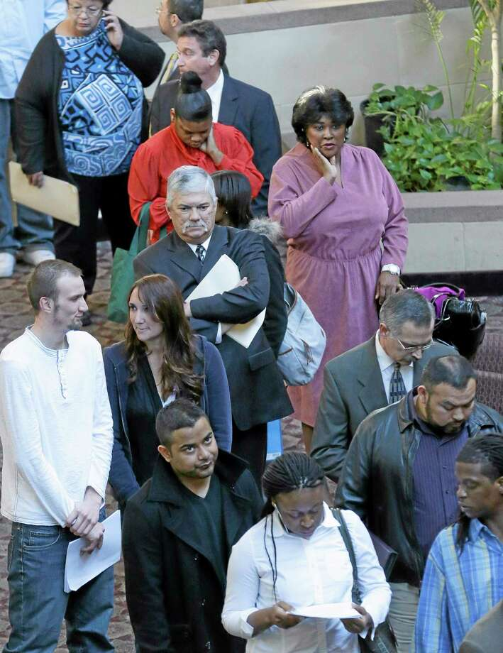 Job seekers line up to meet prospective employers at a career fair at a hotel in Dallas, Wednesday, Jan. 22, 2014. The Labor Department reports Thursday March 13, 2014 on the number of people who applied for unemployment benefits last week (AP Photo/LM Otero) Photo: AP / AP