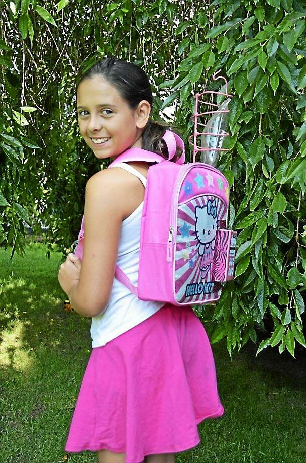 Naugatuck resident Kylie Simonds, 11, a survivor of a rare childhood cancer, was honored for a chemo backpack she designed. Photo: Connecticut Women's Hall Of Fame