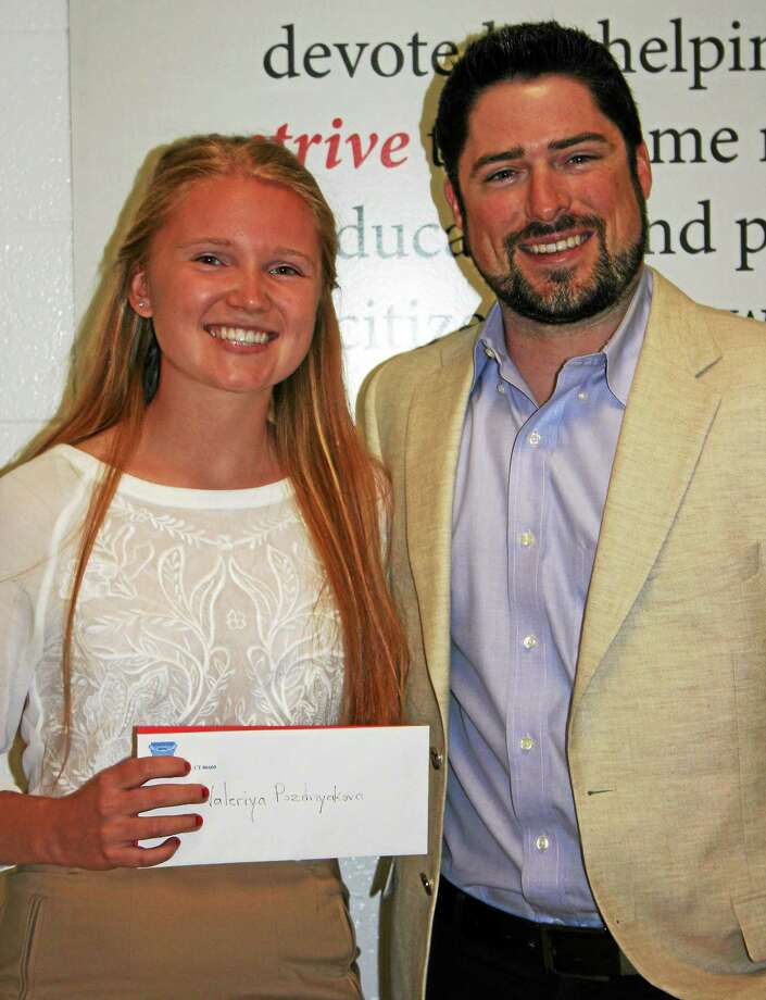 Valeriya Pozdnyakova, left, was presented with the 2014 Britton John Broatch Memorial Scholarship recently by Britton's brother, Kierran Broatch, at Joseph A. Foran High School in Milford. Pozdnyakova will study biochemistry at Quinnipiac University in the fall. A fundraiser for the Britton John Broatch Memorial Foundation will be held 6-9 p.m. July 12 at Crush Sports Cafe, 1015 Bridgeport Ave., Milford. The event will include tastings of wine, beer and bourbon, as well as food, live music and raffles. The 11th annual fundraiser is in honor of lifelong Milford resident and Foran graduate, Britton Broatch, who died of a stroke in 2003 at age 25. After nine years of holding popular Wiffle ball tournaments, fundraiser organizers switched the format last year. The foundation was created by family and friends shortly after Britton's death and gives annual scholarships to Foran High seniors. Tickets for the tasting are $40 and can be purchased by mailing a check or money order to: The BJB Memorial Foundation, P.O. Box 8, Milford 06460; or at gbroatch@thebjbtournament.com. For more information,call Broatch at 203- 623-1193. The foundation also donates to such charities as Crop Walk, Habitat for Humanity, Camdyn's Fund, Tex Kane Scholarship Fund, the Heron Family Fund, the Ralph J. Russo Fund, the Mike Burke Educational Fund, the John Tartaglio Fund, the MS Society and Oxfam. Photo: Journal Register Co.