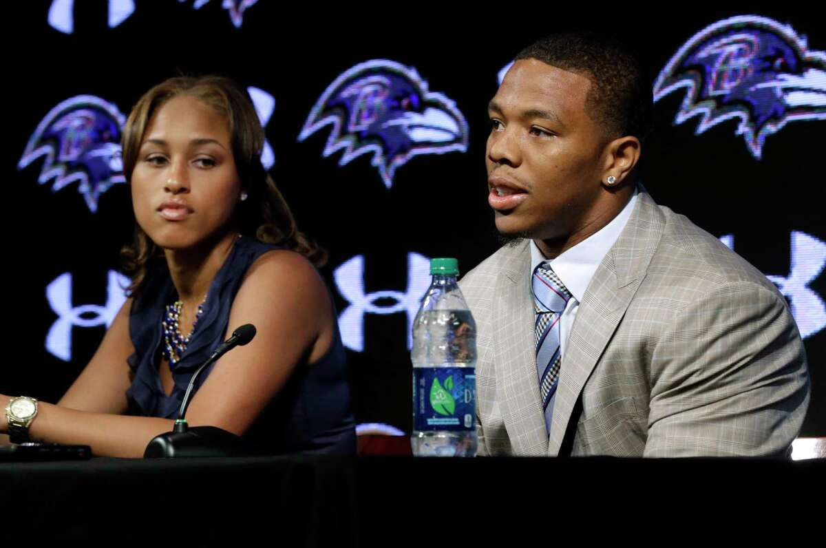In this May 23, 2014 file photo, Baltimore Ravens running back Ray Rice, right, speaks alongside his wife, Janay, during a news conference at the team's practice facility in Owings Mills, Md. A new video that appears to show Ray Rice striking then-fiance Janay Palmer in an elevator last February has been released on a website.