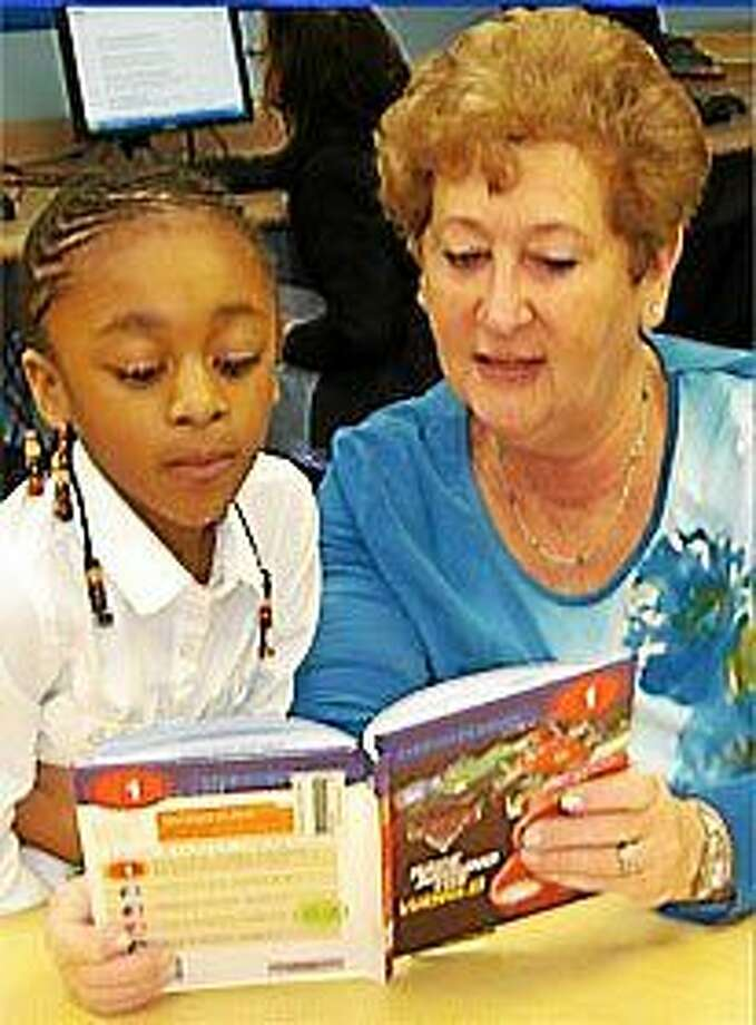 The Jewish Coalition for Literacy is seeking volunteers to become reading partners to students in area public schools. Photo: Journal Register Co.